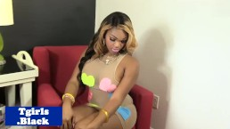 Busty black tranny posing and pulling her rod