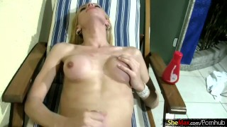 Sexy blonde tranny strips naked for the camera and wanks