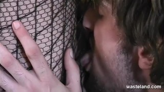 Kinky brunette slave girl suspended in a net sucks her masters cock dry