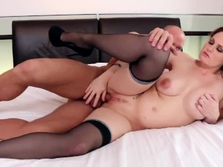 Busty cutie Allison Moore fucking on a bed in black thigh high stockings