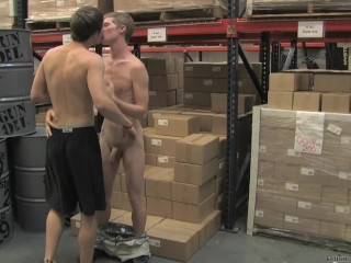Two young twinks having sex in warehouse
