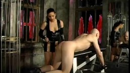 Three raunchy playgirls give this kinky stud a proper spanking