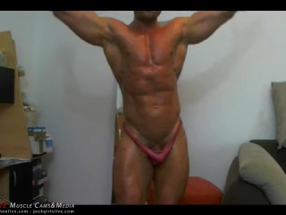 Emilio, scarcely dressed, flexes and poses, showing off his perfect abs