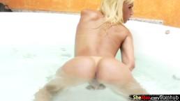 Slim Latina shemale in black bikini masturbates in jacuzzi
