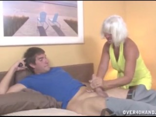 Granny jerking the young guy...