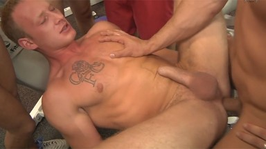 Bareback group sex in a gym
