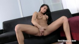 Horny Lexi Dona fingers her snatch on a leather couch
