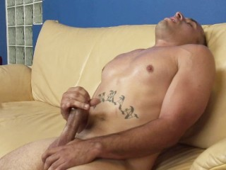 Tattooed latino dude shows off his cock and jerks off