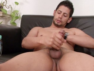 Latino stud teases and strokes his cock