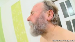 Naughty young girl with pigtails cheats her boyfriend with an old man
