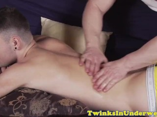 Aroused twink jerking his cock during massage
