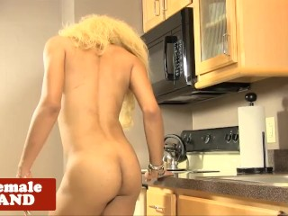 Heeled ebony tranny tugging her hard cock