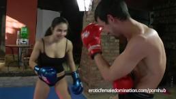 Boxing dominatrix hitting slave hard