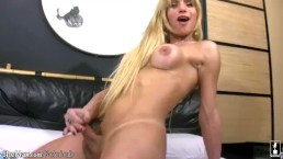 Pretty face blonde shemale strips off and wanks big shecock