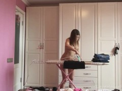 Ironing the kinky clothes while completely naked