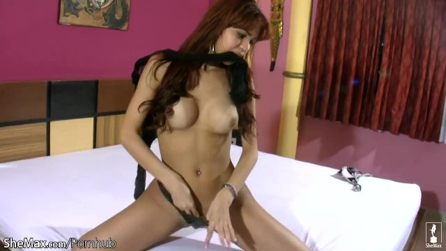 Pretty face shemale flashes her massive ass in latex thongs 11