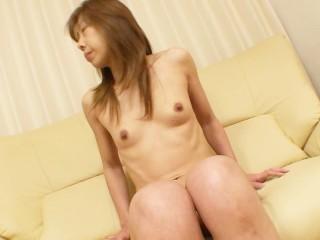 Petite Japanese cougar Aki Iwashita strips for vibrator play and sex