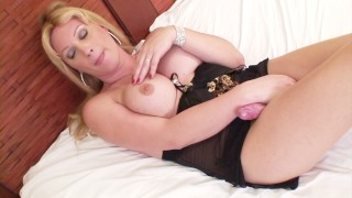 Hot blonde shemale Duda Dihl in sexy black lingerie masturbates