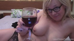 Wine-drinking amateur blonde masturbates with her glasses