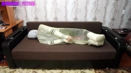 Tied boy encasement in fishnet bodybag