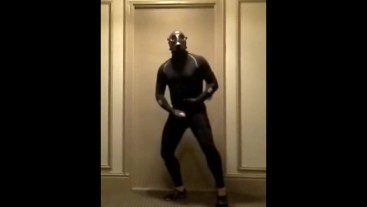 masked bicyclist jerking off in hotel hall