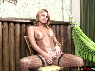 Bigtitted tranny covers her dick in whipping cream...