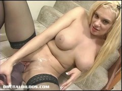 Busty blonde in thigh highs loving a big brutal dildo