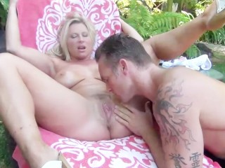 Curvy blonde MILF Devon Lee gets oiled up and fucked by the pool