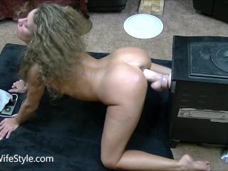 Hot brunette fucks huge dildo doggystyle on her knees