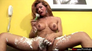 Redhead t-babe enjoys shaving her shecock and massive ass