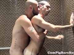Mature bear barebacks cub in shower