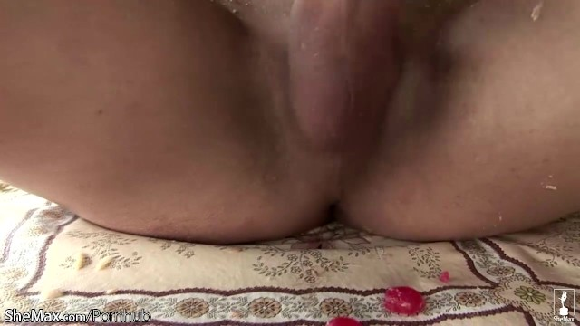 Sharp horny tranny is teasing her thick boner with a hatchet 1
