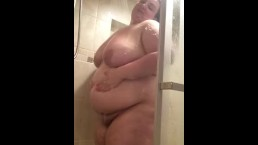 Busty bbw with a jiggly belly in the shower