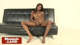 Ebony tgirl jerking her hung uncut cock solo