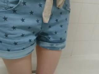 little girl wets her denim shorts