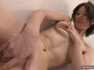 Sexy ass Asian babe takes a naked shower as she shakes