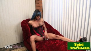 Busty black trap tugging cock on couch