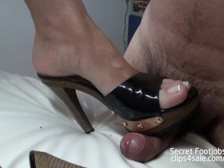 Andrea gives hot footjob in sexy clogs!