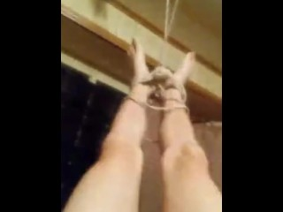 Tied to ceiling by ankles made to cum and be penetrated
