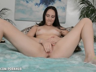 black haired hairy babe rubs her pussy