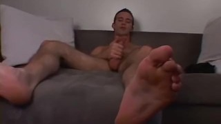 A tall hunk is jerking his cut cock while playing with socks Couch anal