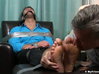 Business man Blayne tied up with duct tape and feet licked