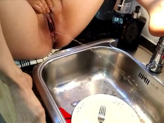 Norwegian piss in kitchen sink with dishes