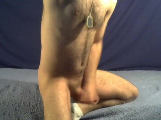 Skinny-fit hairy cub stroking horse cock while flexing ass