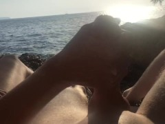 A sunset handjob on a nudist beach with a happy ending