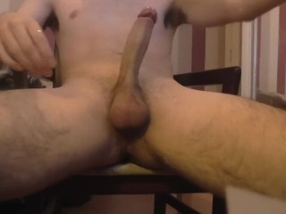 horny naked solo male stroking his lubed hard cock while watching Pornhub
