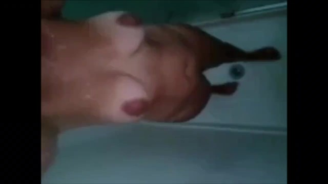 Milf taking a shower Milf taking a shower