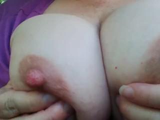 Close up public nipple play