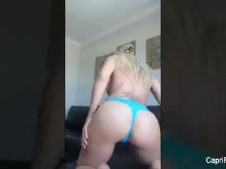 Home video of Capri Cavanni teasing her big tits