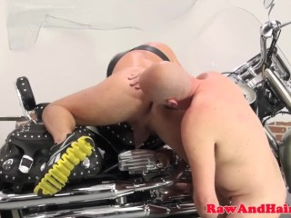 Silver biker wolf spreads ass for bare cock